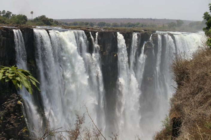 Victoria Falls...Formed by the rapids of Zambezi river, which is the 4th largest in African river. The fog from the falls make the surrounding receive rainfall 24/7.