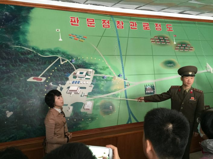 North Korean border officer explaining The Korean Demilitarized Zone which serves as a buffer zone between North and South Korea. It cuts Korean peninsula roughly in half, it is 250 kilometers long and 4 km wide.
