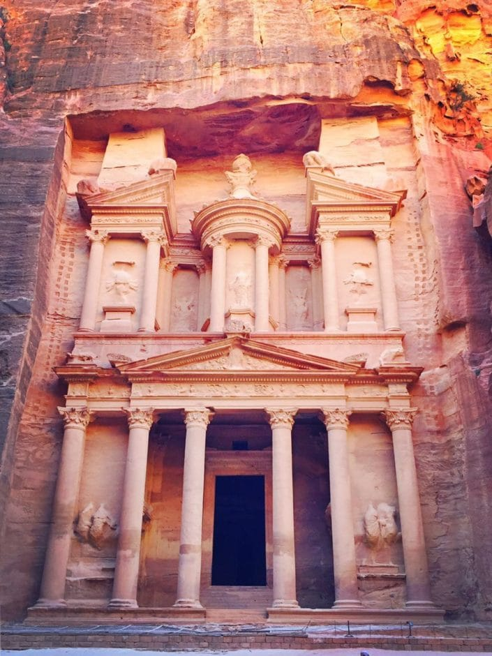 Al Khazneh, otherwise known as the Treasury. The temple was carved out of rose colored sandstone rock face. Originally built as a mausoleum.