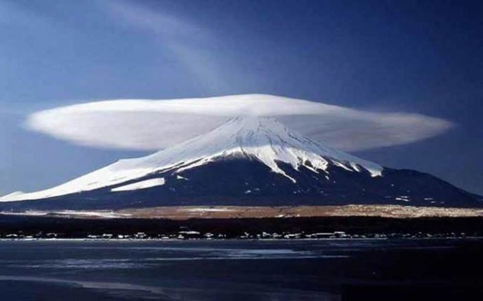 Lenticular cloud formed at high altitudes.